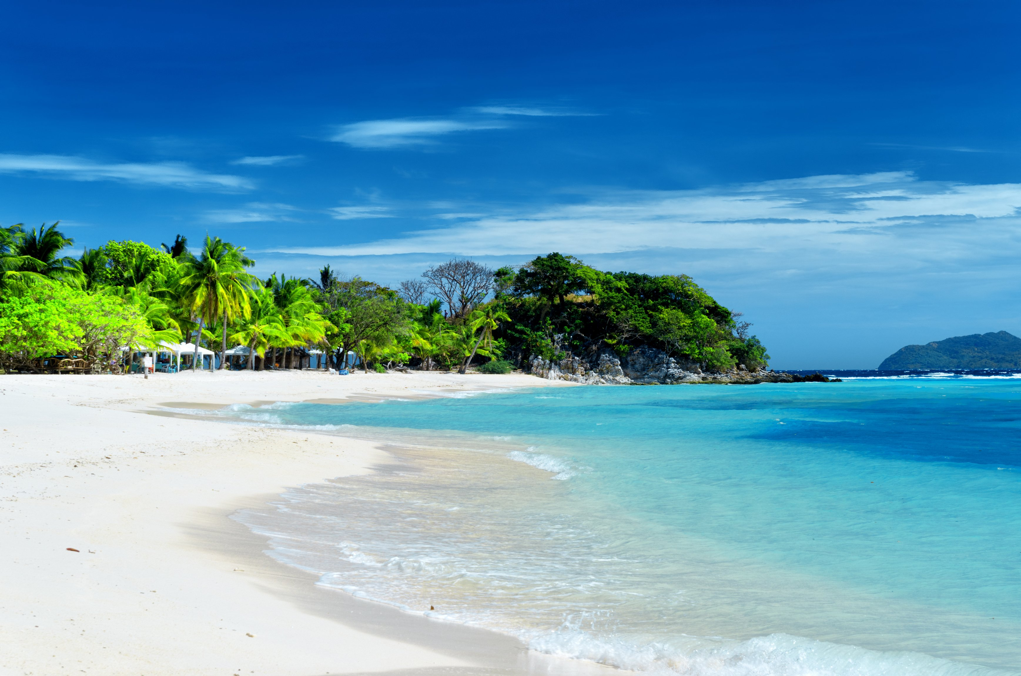 Spiaggia bianca incontaminata dell'Isola Malcapuya